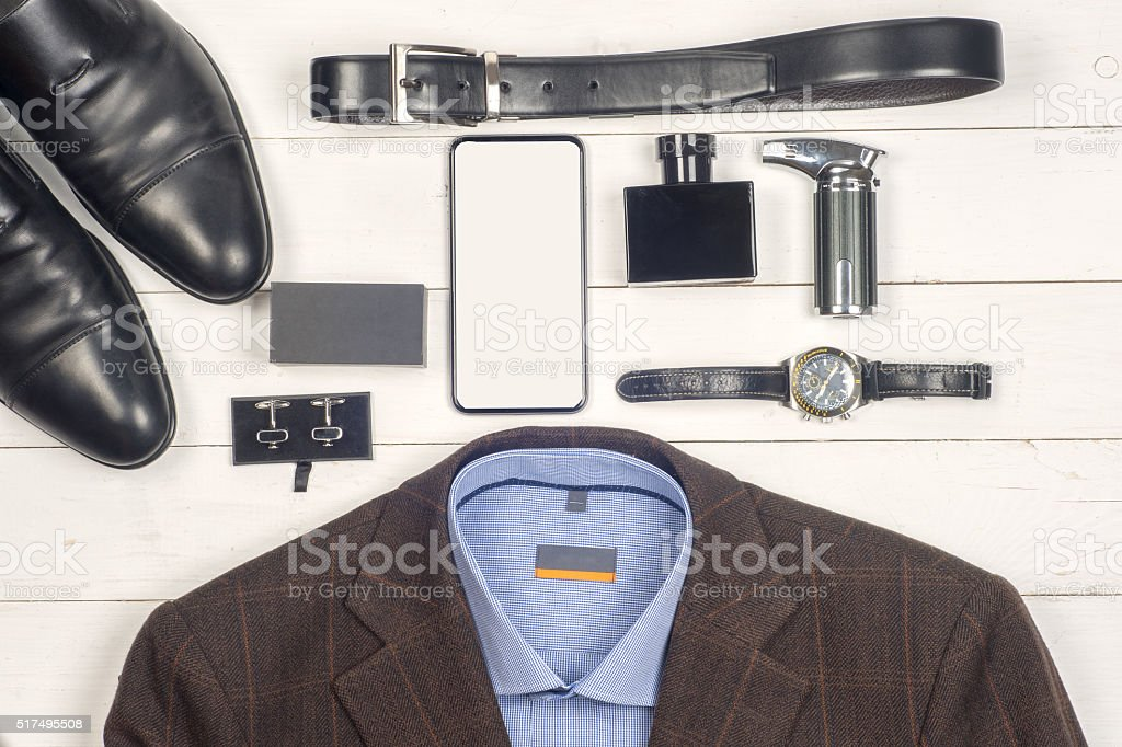 Men's casual clothes and accessories on wooden background stock photo