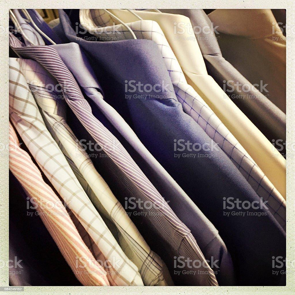 Men's Dress Shirts on Hangers stock photo