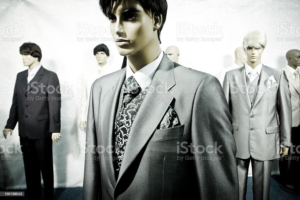Men's Dummies in elegant suits, window display in clothing store royalty-free stock photo