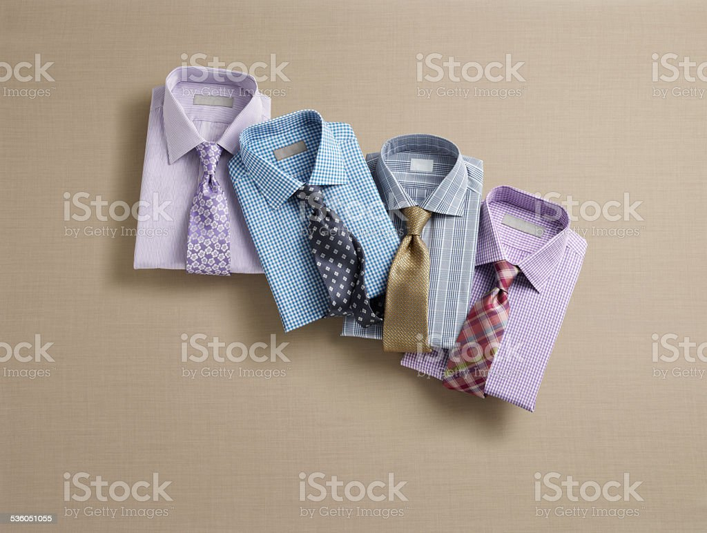Mens Fashion Grouping of folded mens dress shirt with neckties stock photo