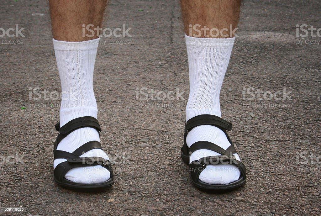 Men's feet in sandals stock photo