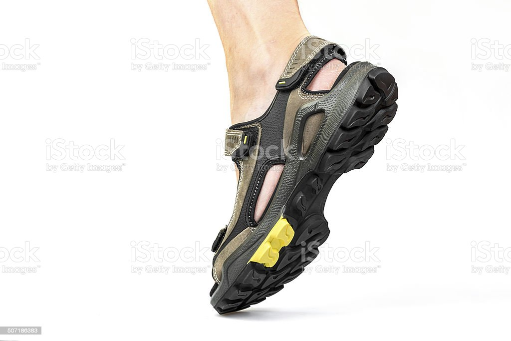 Men's foot in sandals on a white background stock photo