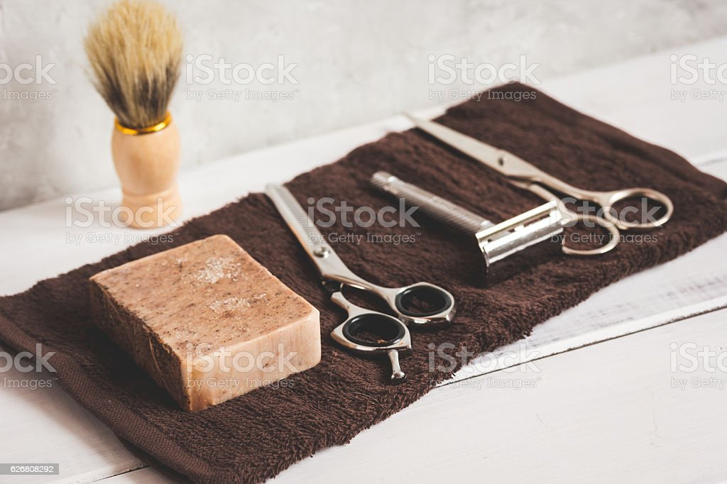 Mens hairdressing wooden desktop with tools stock photo