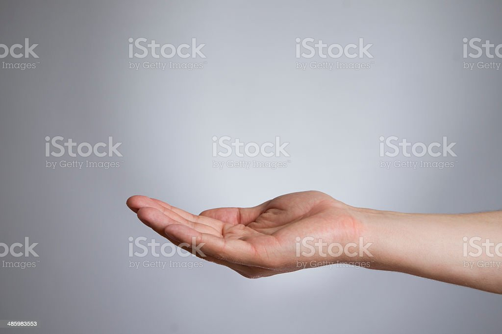 Mens hand on a black background stock photo