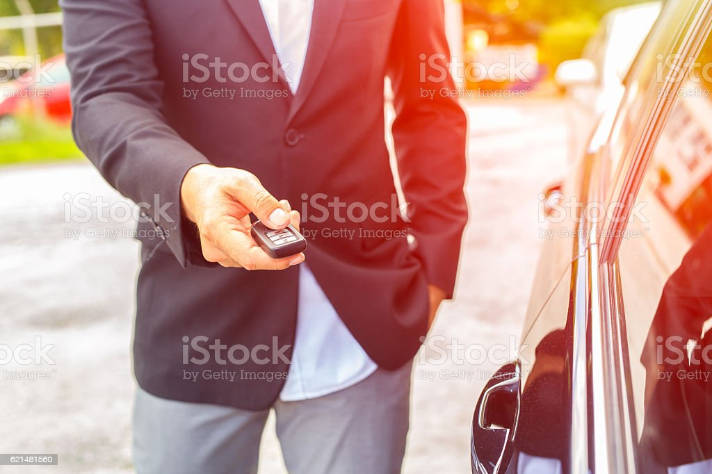 Men's hand presses on the remote control car stock photo