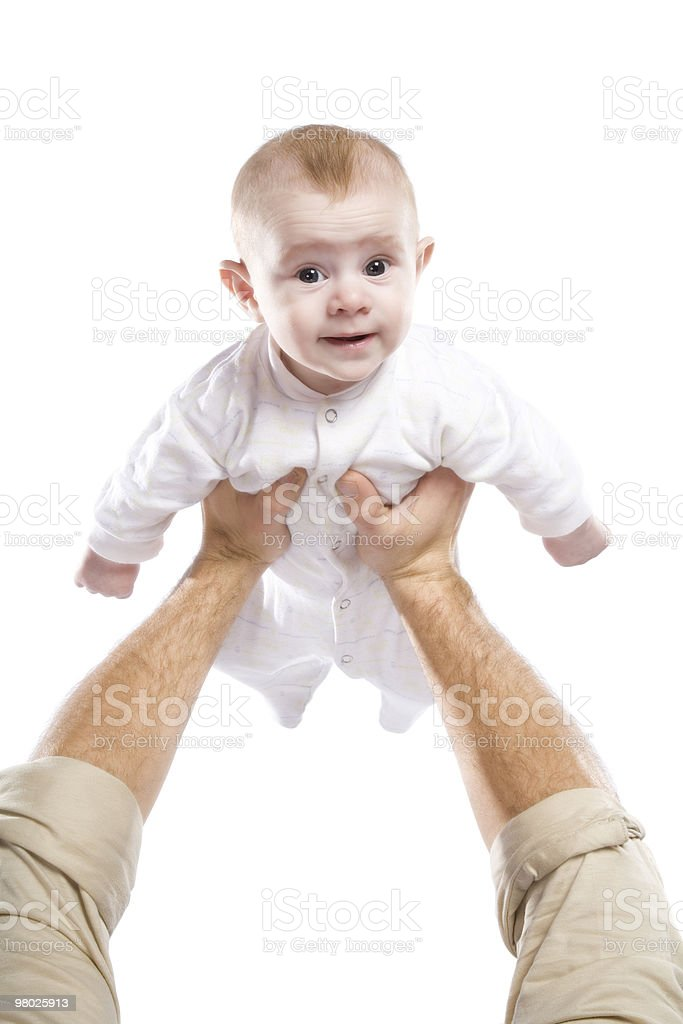 Men's hands hold the baby royalty-free stock photo