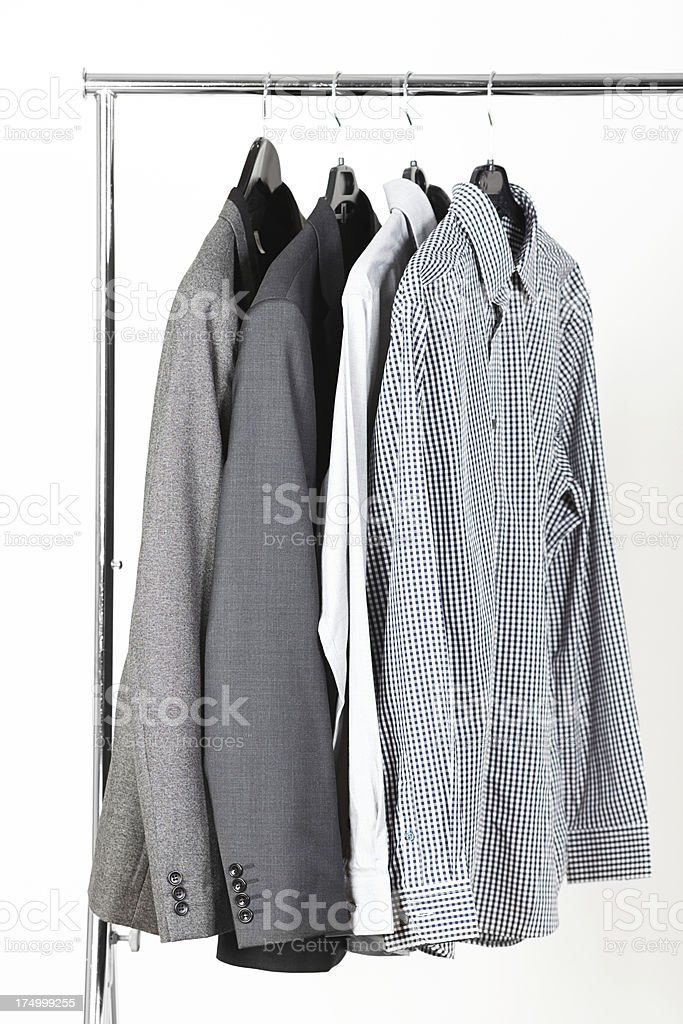 Men's jackets and dress shirts on rack royalty-free stock photo