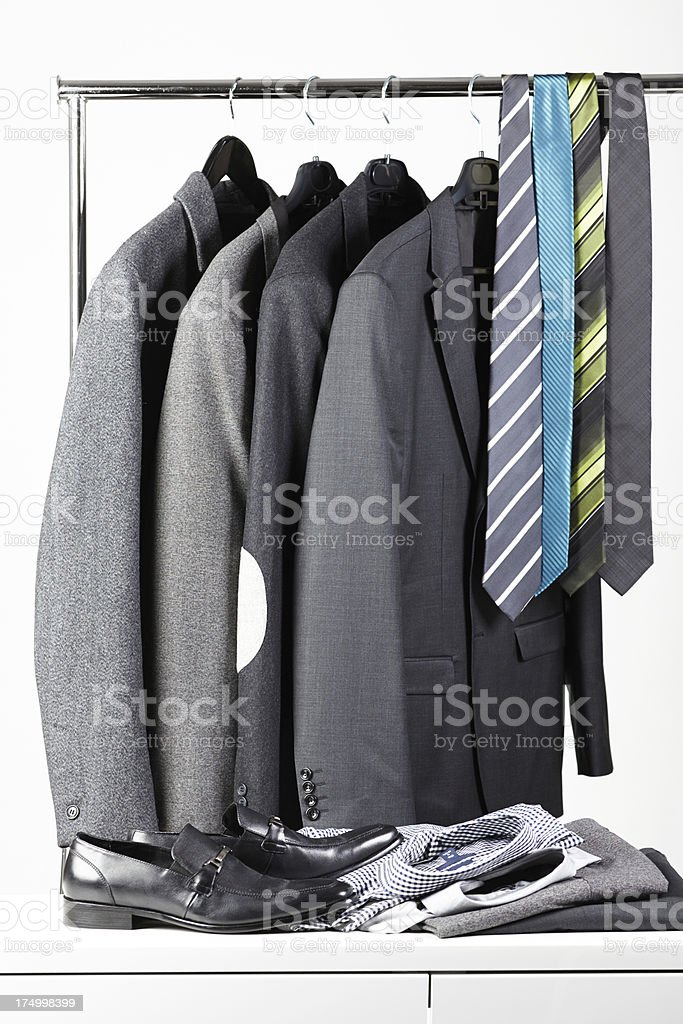 Men's jackets, shirts and ties on rack royalty-free stock photo