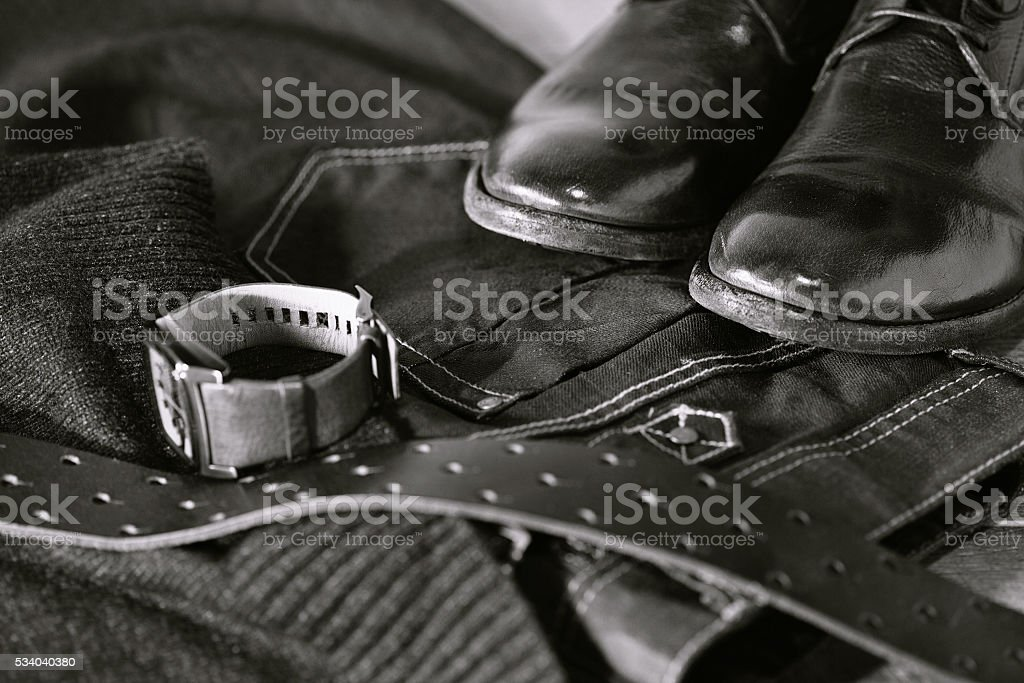 men's jeans, sweater, leather shoes, belt and watch stock photo