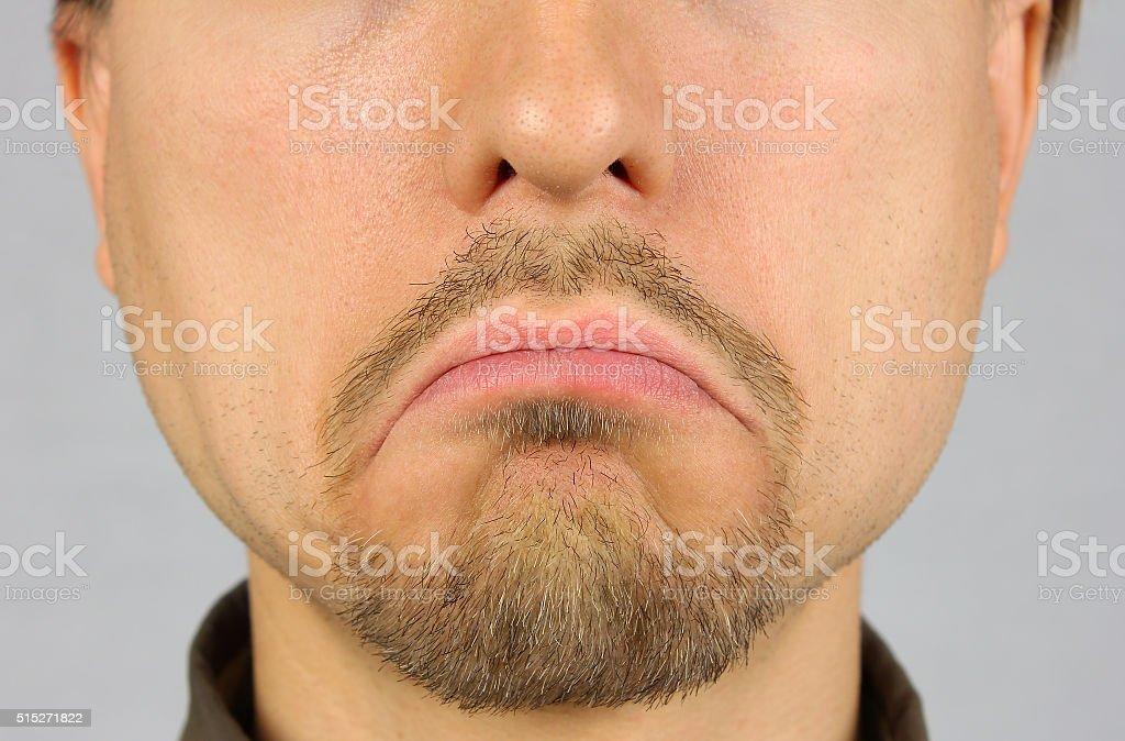 men's lips corners down, sad, closeup stock photo