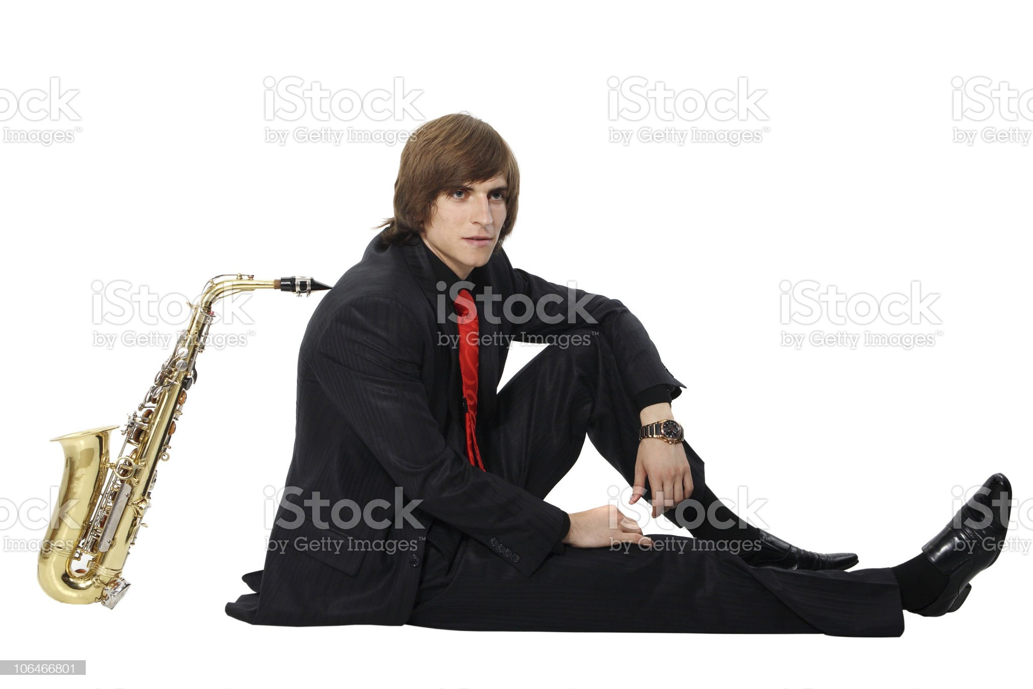 Men's long sitting with sax royalty-free stock photo