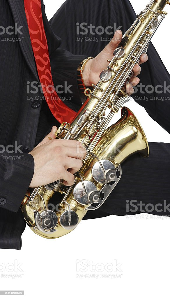 Men's long sitting with sax stock photo