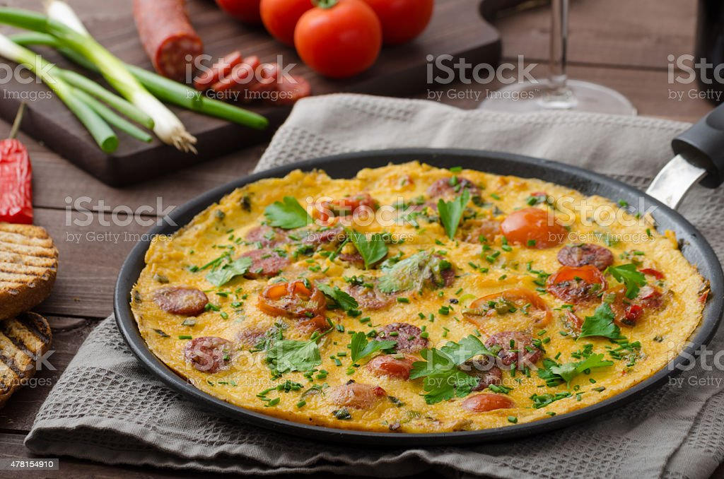 Mens omelette with chorizo stock photo