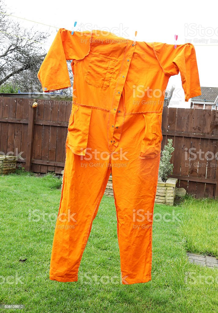 mens overalls on washing line stock photo