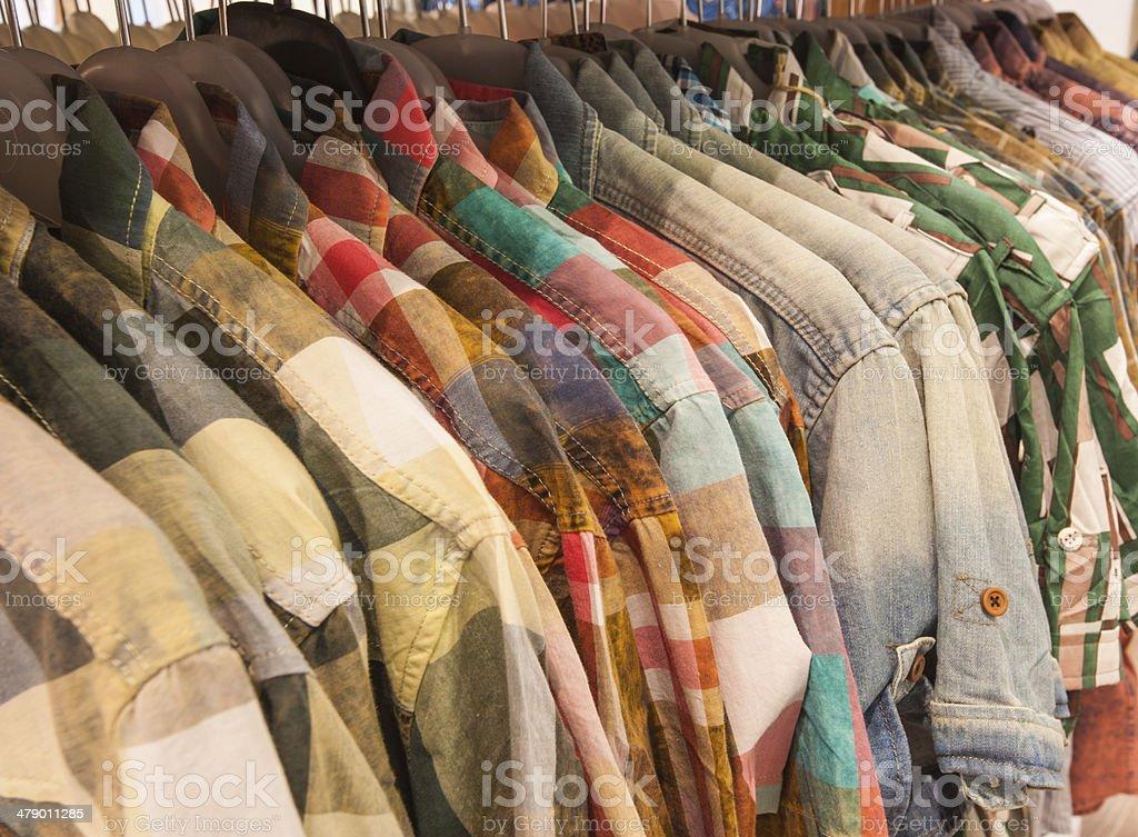 Mens shirts hanging on a rail stock photo