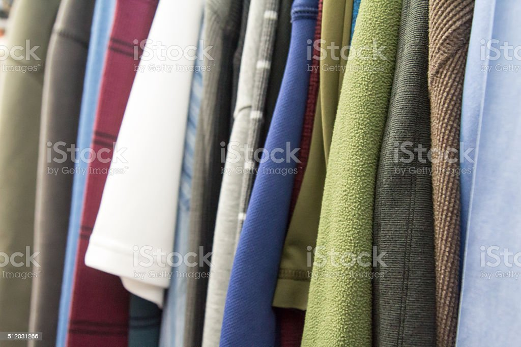 Men's shirts in a closet, full frame stock photo