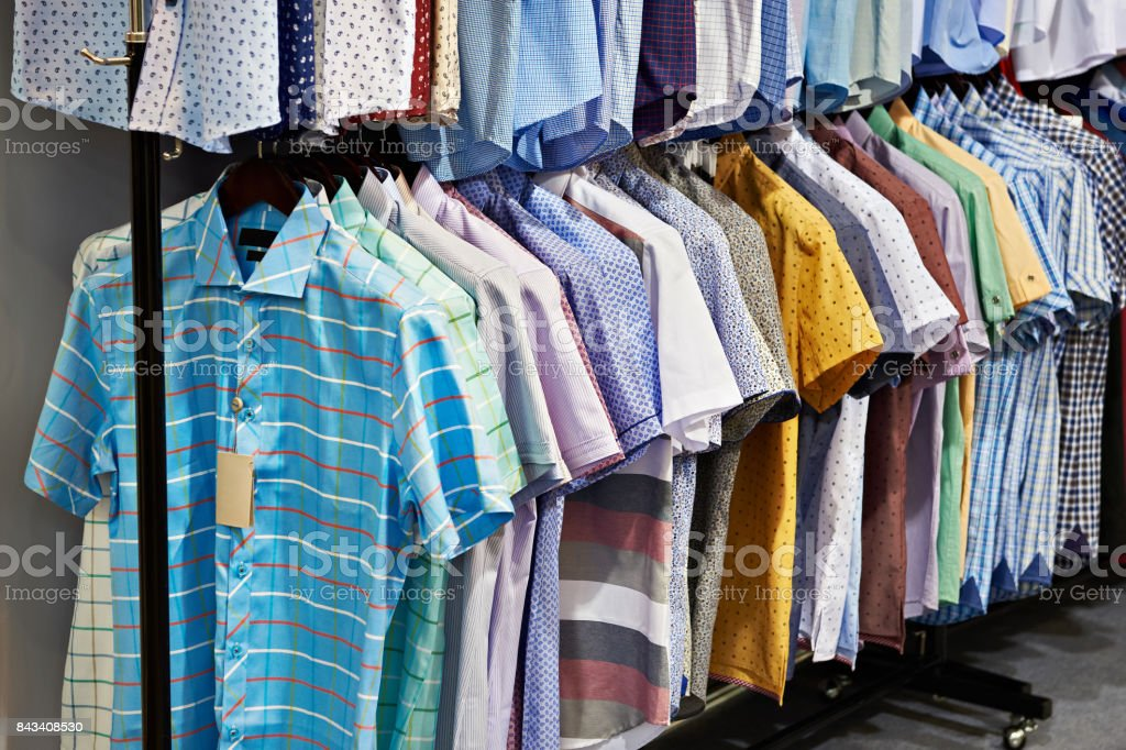 Men's shirts with short sleeves in store stock photo