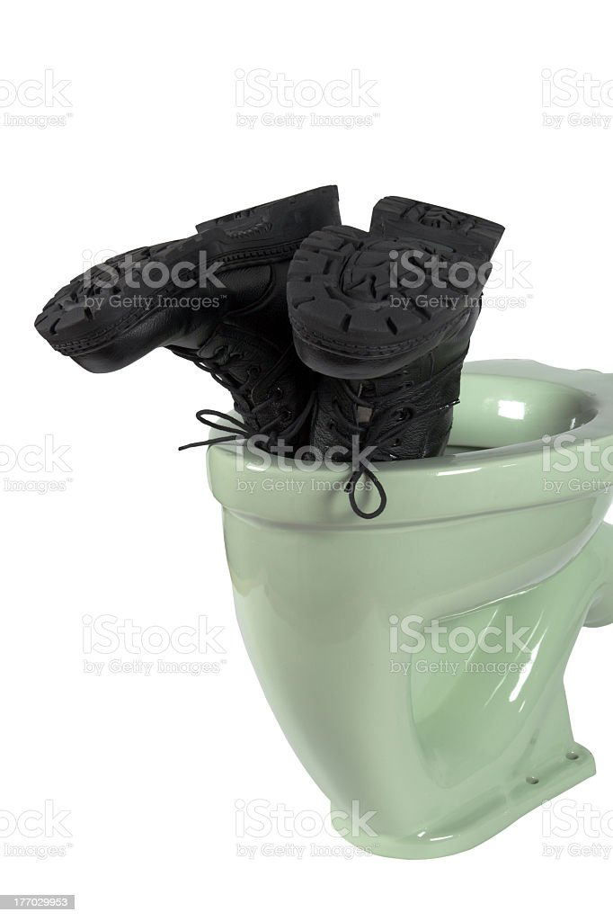 Men's shoes and light green toilet (isolated) stock photo