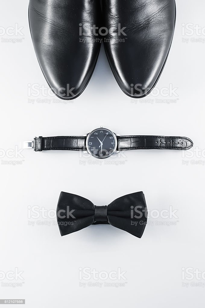 Men's shoes bow tie and watch stock photo