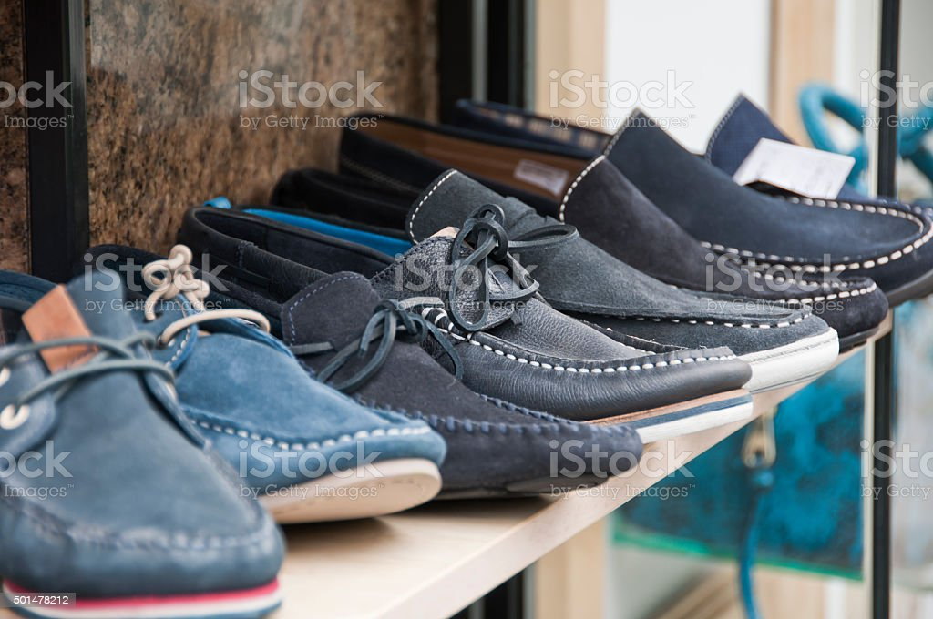 Men's Shoes on Shelf in Store stock photo