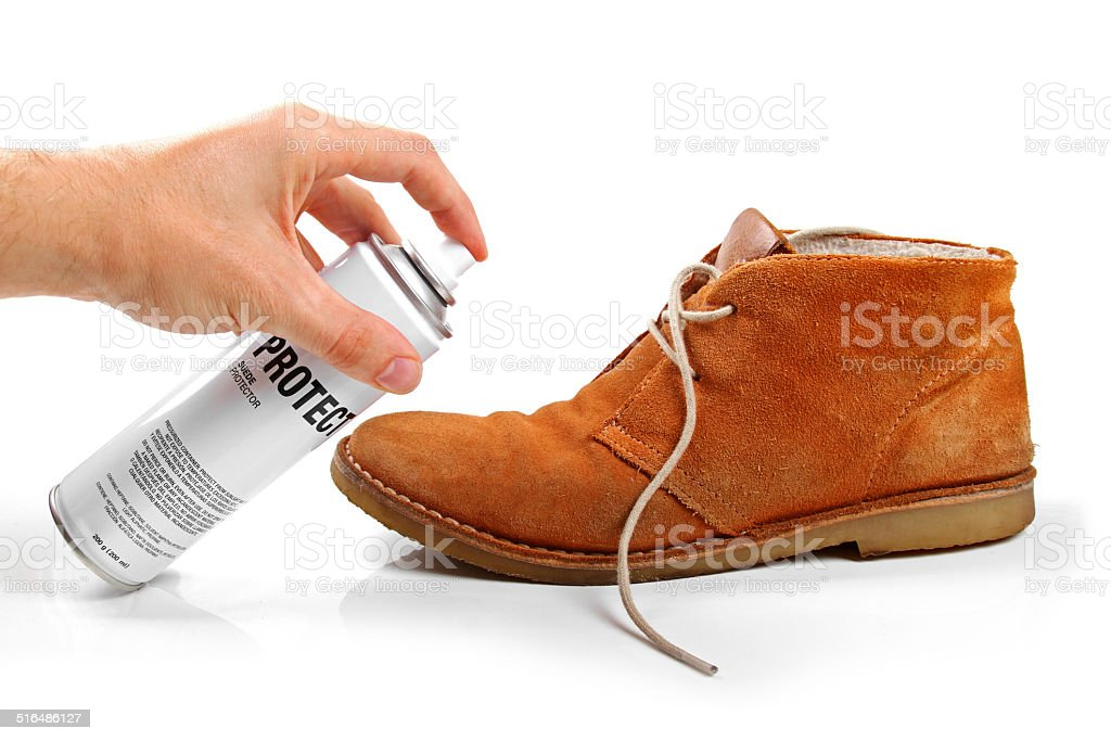 men's suede shoe protection with spray stock photo