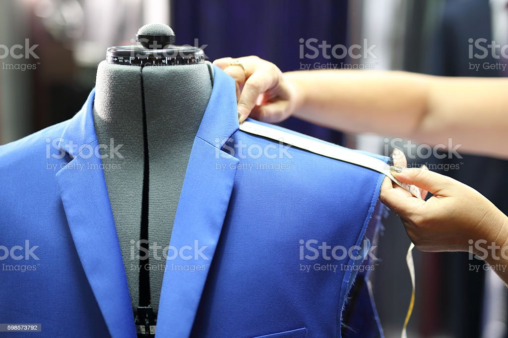 Men's tailoring, sewing jackets. stock photo