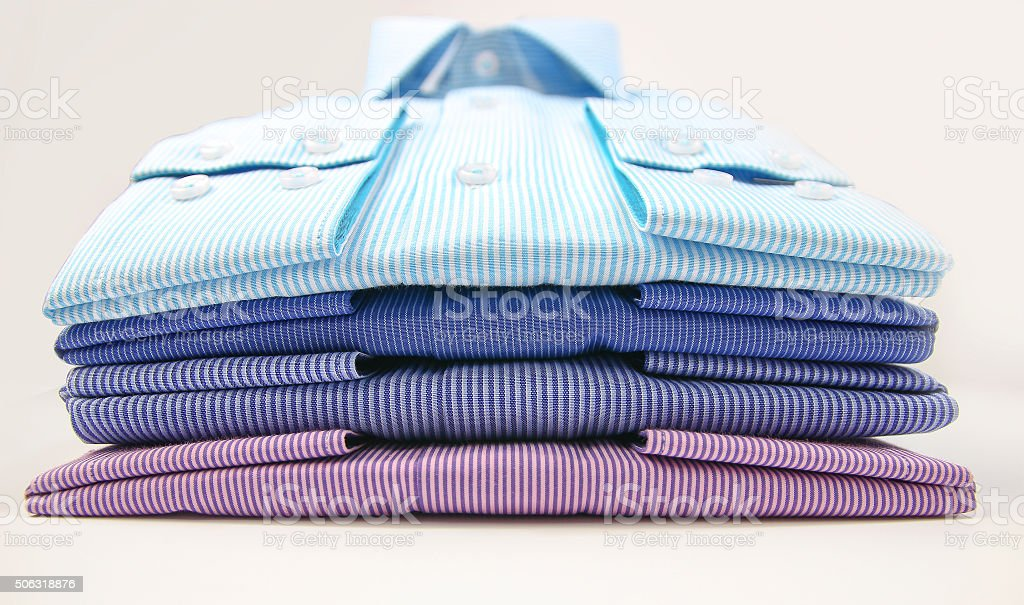 Mens t-shirt folded on background stock photo