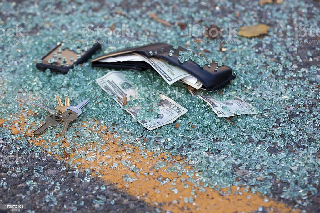 Mens wallet with US Currency, broken glass; parking lot crime royalty-free stock photo
