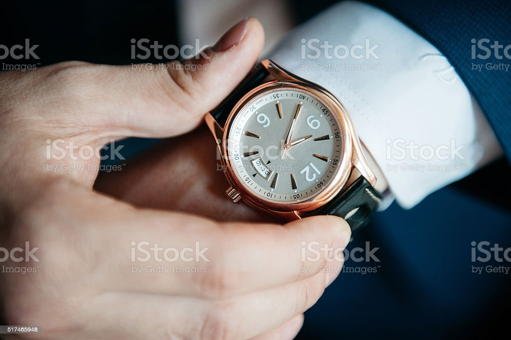 men's watch on his hand close-up stock photo