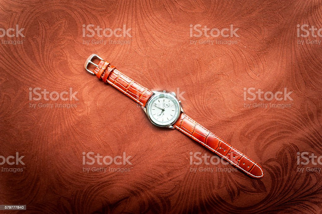 Men's wristwatches on brown background stock photo