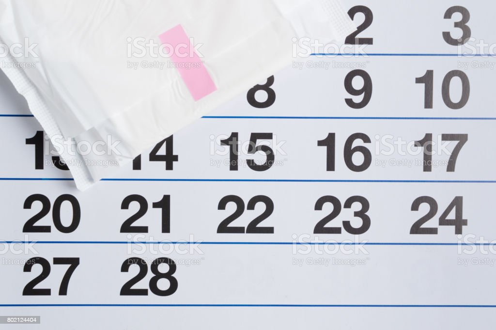 Menstrual calendar with tampons and pads. Menstruation time. Hygiene and protection stock photo
