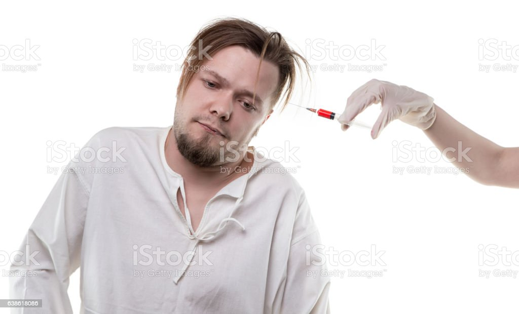 Mental patient and syringe stock photo