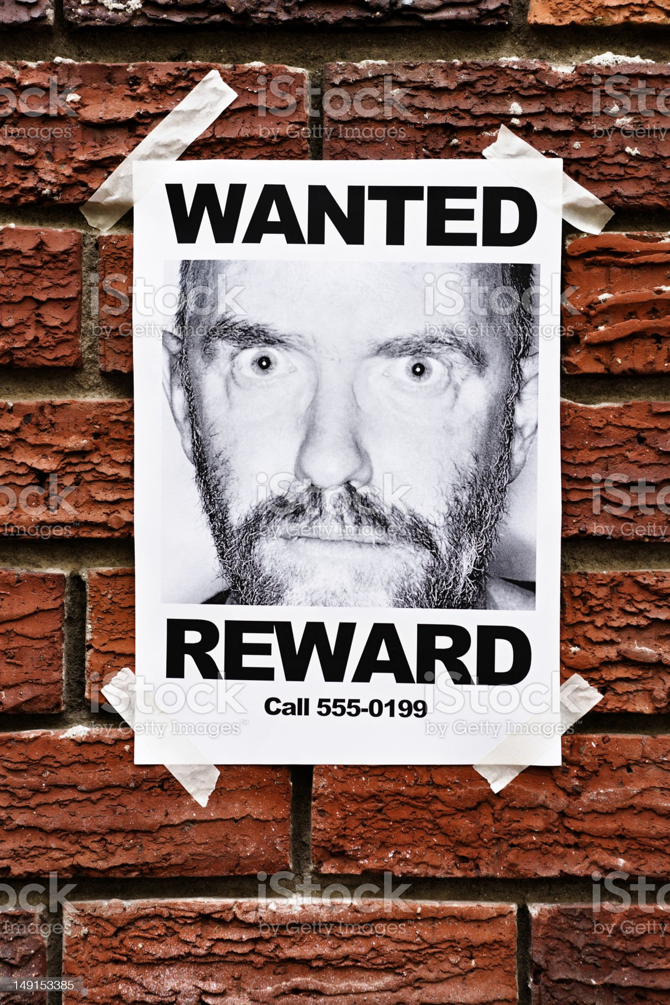Mental patient or criminal? Wanted poster on brick wall royalty-free stock photo