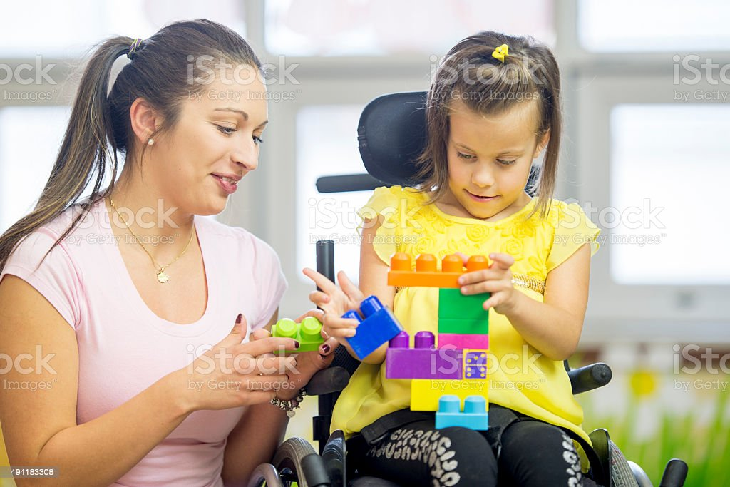 Mentally Disabled Girl Playing with Blocks stock photo