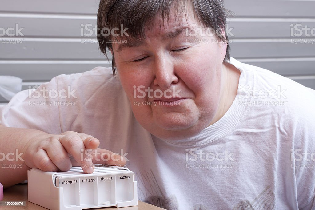 mentally disabled woman with pharmaceutical royalty-free stock photo