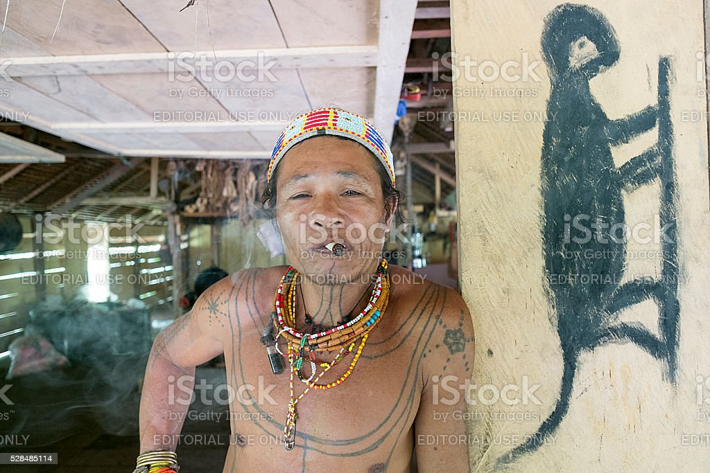 Mentawai tribe pose for camera in the deep of jungle stock photo