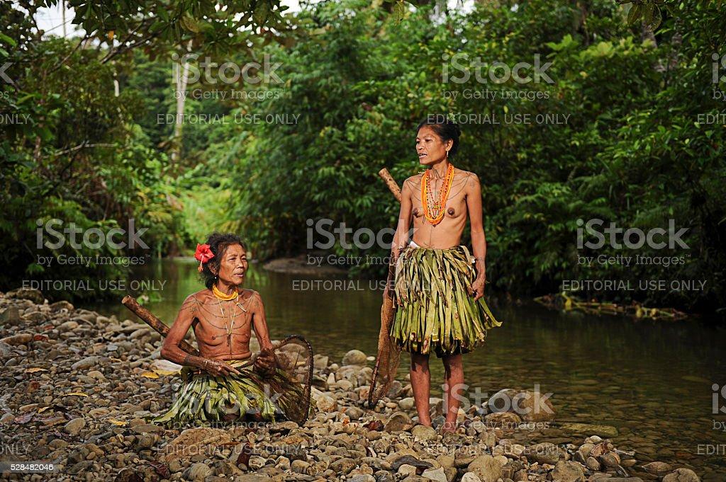 Mentawai womens pose for camera. stock photo