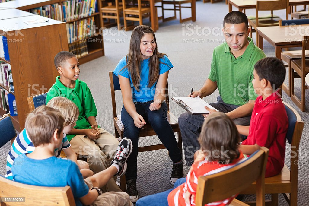 Mentor or teacher in discussion study group with students stock photo