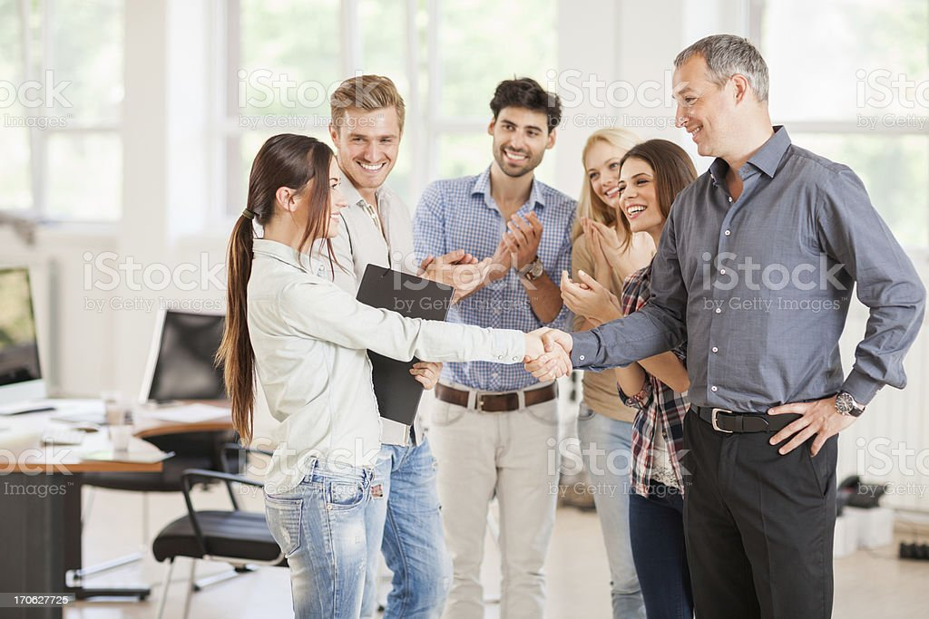 Mentor shaking hand with student royalty-free stock photo