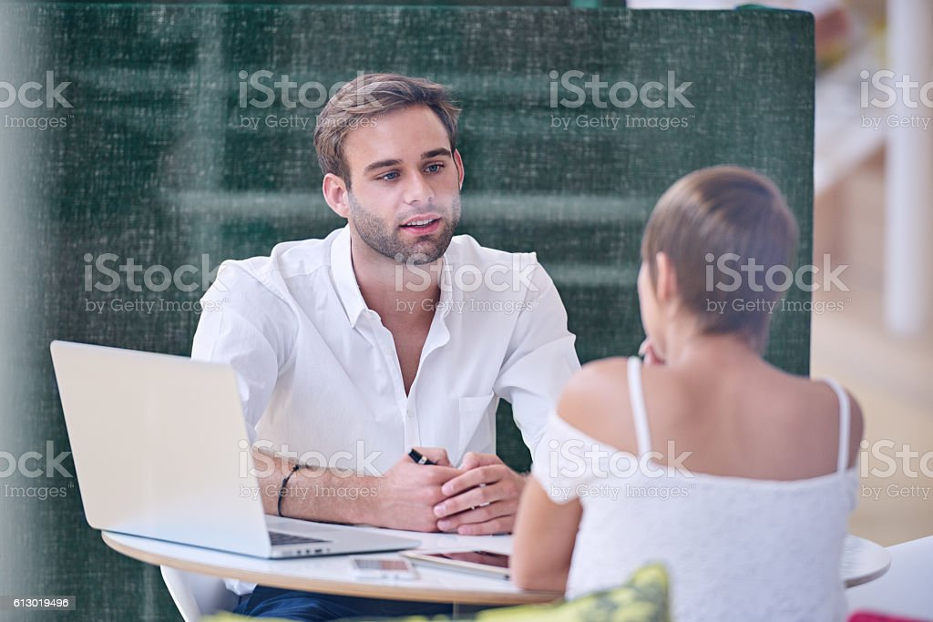 Mentorship between knowledgable male mentor and bright female student stock photo