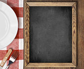 Menu blackboard top view on table with plate, knife and