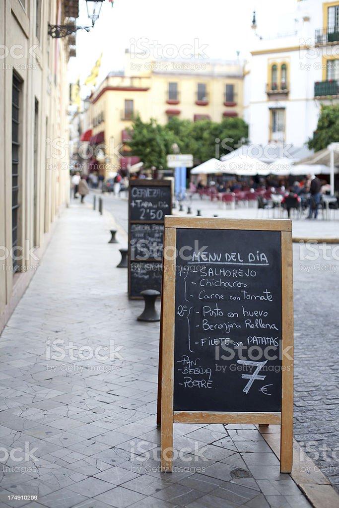 Menu board outside restaurant in Seville, Spain royalty-free stock photo