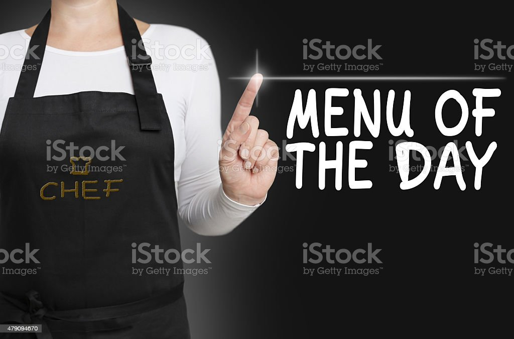 menu of the day touch screen is operated by chef stock photo