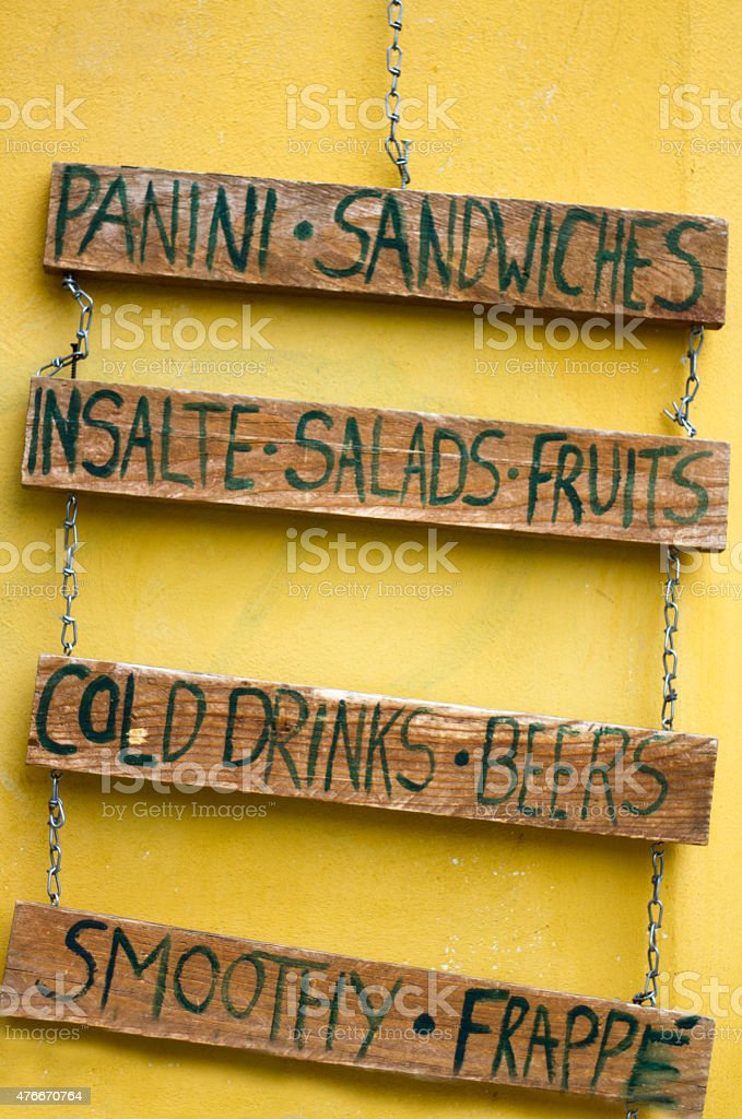 Menu on Rustic Wood Slats, Yellow Wall, Italy stock photo