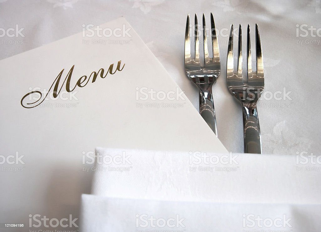 Menu on the table near two forks royalty-free stock photo