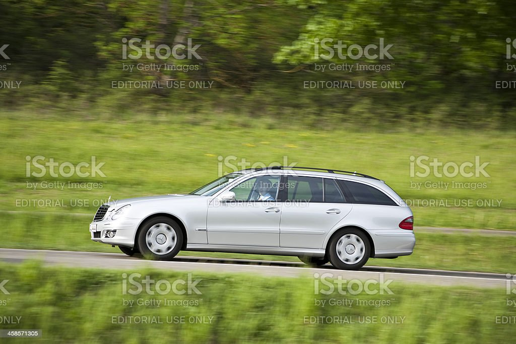 Mercedes Benz E-Class Driving on Country Road in Spring royalty-free stock photo