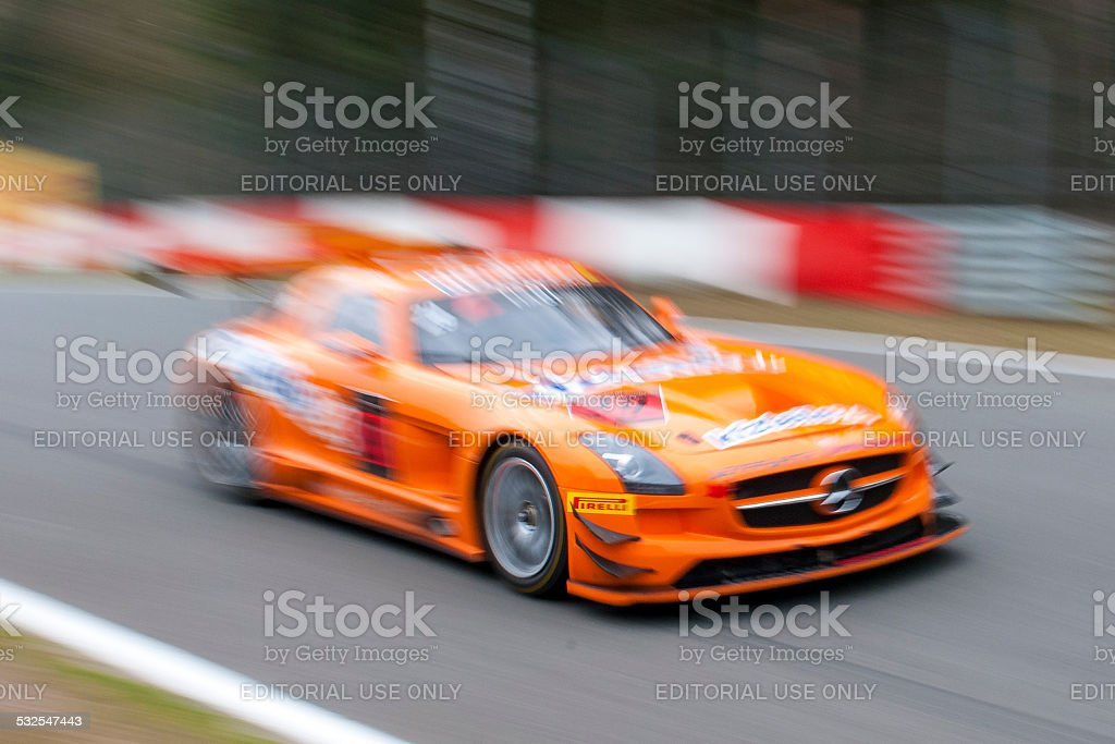 Mercedes Benz SLS AMG GT3 race car at high speed. stock photo