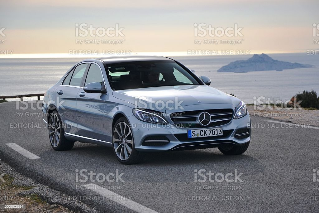 Mercedes C-Class stopped on the road stock photo