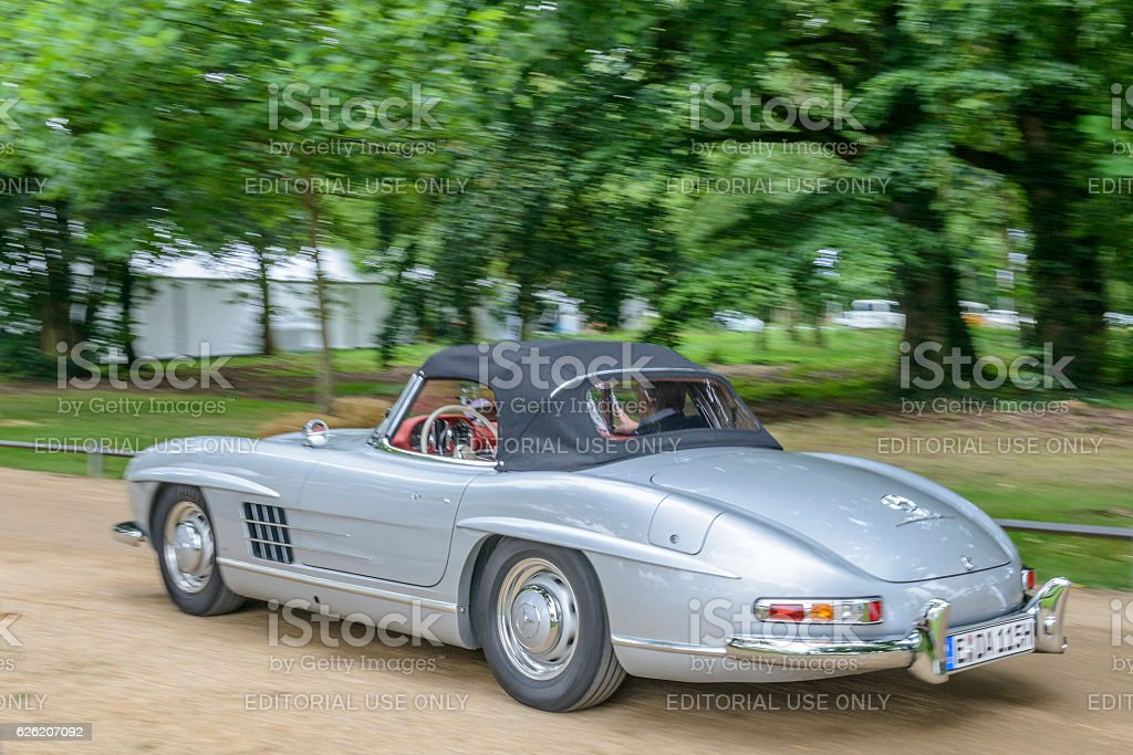Mercedes-Benz 300SL Convertible driving by stock photo