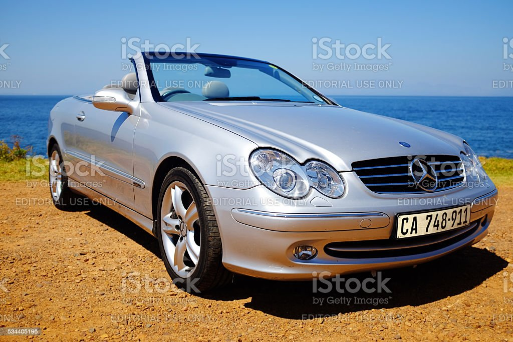 2005 Mercedes-Benz CLK500 convertible roof down, by the ocean stock photo